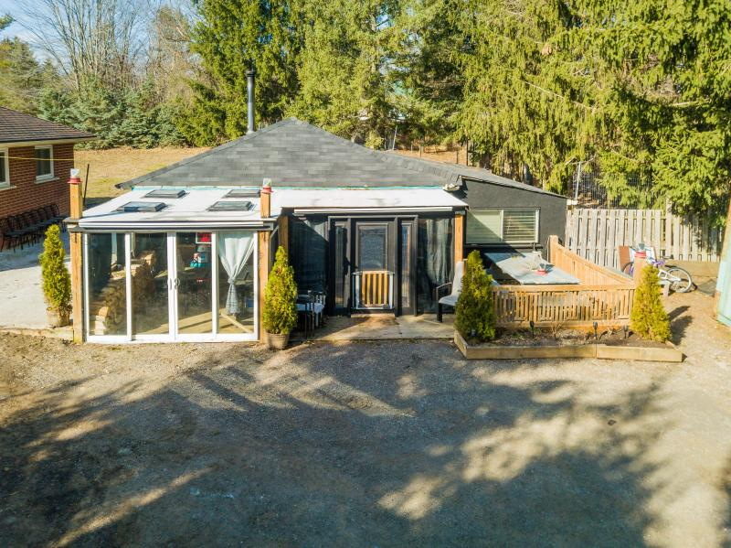 3 Car Garage with Covered Porch, Man Cave and Wood Stove